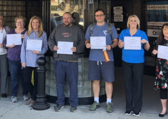 Pineville Be Boss Online grads show their certificates