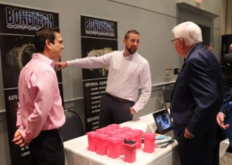 Bondtech representatives speak with Representative Hal Rogers at the SEED symposium