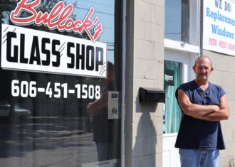 Owner Steve Bullock in front of his business, Bullock's Glass Shop