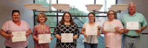 Corbin Be Boss Online graduates display their certificates